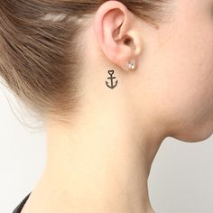 Small anchor temporary tattoo behind the right ear. Buy here