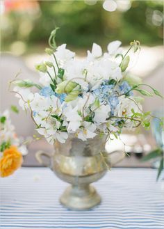 blue and white wedding centerpieces #centerpiece #weddingreception #weddingchicks http://www.weddingchicks.com/2014/01/30/jekyll-island/