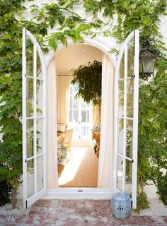 """""""Beautiful doors leading to the garden with crisp white trims create a gorgeous contrast for the surrounding greenery. """" Natalie Fermoyle Photo credit: Interiors by studioM Mark Sikes, Arched Doors, Oak Doors, Arched Windows, Arched Interior Doors, Windows And Doors, Exterior Doors, Front Doors, Hollywood Hills"""
