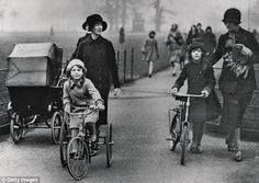 The girls, Princess  Elizabeth and Sonia Graham-Hodgson, riding their tricycles in the park in 1953 accompanied by their nannies