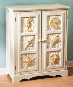 Seashell Cabinet Coastal theme cabinet with seashell, seahorse, sand dollars and more sea shells! Decorative bottom accent finishes off our beach furniture cabinet. Seaside Decor, Beach House Decor, Coastal Decor, Home Decor, Coastal Style, Beach Furniture, Furniture Decor, Wooden Furniture, Beach Cottage Style