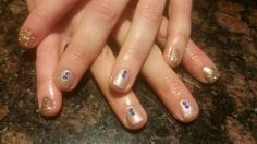 Shellac nails in Grand Gala with some glitter and blue crystals.