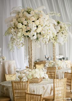 Over the Top Glamour is Totally on Trend. And you can't go wrong with elaborate white and gold centerpieces like these made of orchids, roses and feathers designed by Karen Tran. This is how I want my wedding to look! Gold Wedding, Wedding Table, Wedding Flowers, Dream Wedding, Gatsby Wedding, Gold Centerpieces, White Centerpiece, Crystal Wedding Centerpieces, Quinceanera Centerpieces