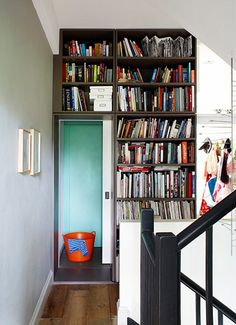 Homes - Narrow house: The landing has been turned into a library with a space-saving sliding door