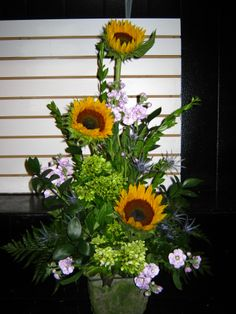 sunflowers, green hydrangea and stock in a pot