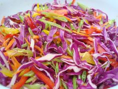The Most Colorful Coleslaw Ever! This rainbow slaw is a great addition to any cookout, picnic, or potluck. And the tamari-sesame vinaigrette is sensational!