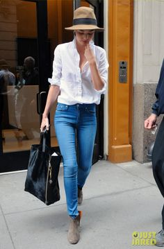 LOVE Miranda Kerr in her Mother Looker Jeans and Isabel Marant Dicker Booties. Perfect!