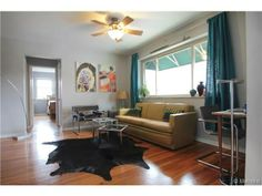 Living Room 2100 Franklin Street UNIT 20, Denver, CO 80205 - #: 8249743 #forsale #condo #denver #realestate #staging #vintage #vintagefurniture #midcentury #midcenturydecor #decor #homedecor #yellow #teal #grey #wassily #chrome