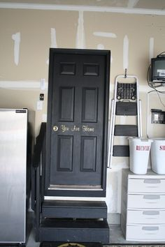 Black Garage Entry Door.  It's calling my name- check out the vinyl letters too - wakes up this busy entryway!
