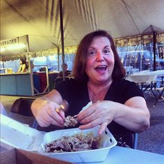 Nonna's work is never done! Deboning chicken at the local Greek Fest.