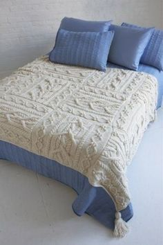 Free knitting pattern Erin Afghan - Lion Brand's afghan is made of 12 blocks of cable sewn together. Knit with two strands held together. About 54 x 72 in. (137 x 183 cm)
