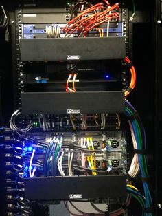 Wiring up the servers in a switch rack.