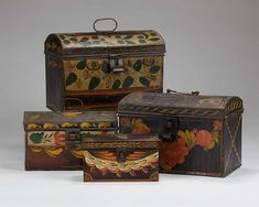 FOUR AMERICAN PAINTED TINWARE DOME-TOP TRUNKS WITH FLORAL AND SWAG DECORATION. http://www.artfact.com/archives
