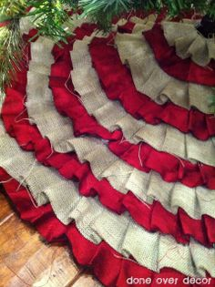 Super cute and looks pretty easy! Hot glue, burlap, red fabric and an old tree skirt.