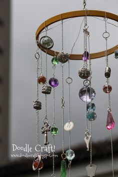 Doodle Craft...: Trinket Chandelier Mobile! Very cool way to use those pretty earring when you lose the other one.