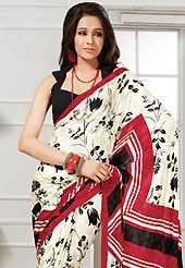 The traditional patterns used on this saree maintain the ethnic look. This light cream, black and red georgette saree is nicely designed with floral and geometric print work. Saree gives you a singular and dissimilar look. Matching black blouse is available. Slight color variations are possible due to differing screen and photograph resolution.