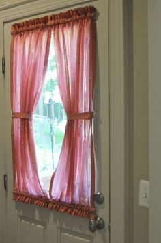 This might be a nice way to do curtains for our back door! {Tutorial link}