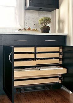 built-in drawers for linens + silverware