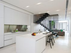 the stair rail. the white kitchen. Photo from Ong&Ong; Architects
