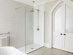 This modern glass screen looks perfect with a traditional shower valve and riser