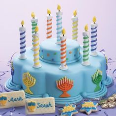 Even if your menorah candles burn too quickly, you'll have the bright lights of our Lights of Hanukkah Cake to admire throughout the celebration. For the spiral design, just wind strips of tinted fondant around dowel rods.