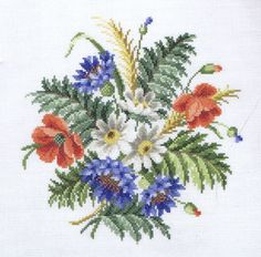 A spray of colourful Summer flowers - poppies, cornflowers and daisies.