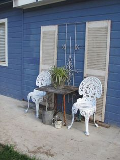 To punctuate a plain exterior wall. White shutters against this deep blue exterior pain, accompanied by French-style chairs gives this patio Caribbean flavor.