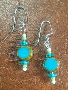 Check out this item in my Etsy shop https://www.etsy.com/listing/232639743/blue-and-green-glass-bead-earrings
