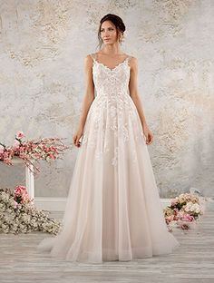 If you want a bit more drama go with this blush ball gown that has both detailing and some romance sewn right in.
