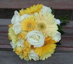 White and yellow roses with white and yellow Gerber daisies. My favorite!