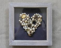 Black and Gold Button/Pearl Heart in Wooden Frame. One off piece. £15.00 on Etsy. Copyright Emily Spenceley, Emravel
