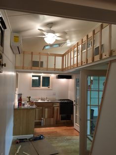 white interior tiny house/tiny home with lofts and catwalk built by Tiny Idahomes