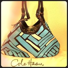 Cole Haan Triangle Choco/Ivry Zoah Lg Custom Hobo Good gently used large brown and ivory with custom blue throughout outside canvas. Antique gold hardware and feet on bottom. Thick braided handles and cream interior with lots of pockets. One small oops inside with green less then dime size ink, please see picture. This bag is quality and holds a lot. This comes with original sales tag and dust an. No tears on hobo at all. Please know the blue is custom done and is one of a kind. Cole Haan…
