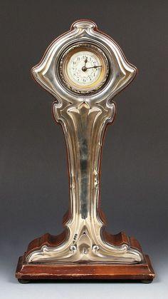 Art Nouveau silver mounted mantle clock