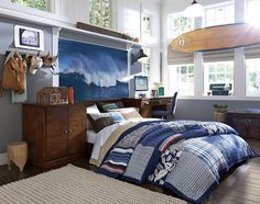 pattern is the bedsheets , the form is the dresser , space is around the room , texture is the bed. the curved line is the surf board corners. the horizontal and vertical lines are the windows.