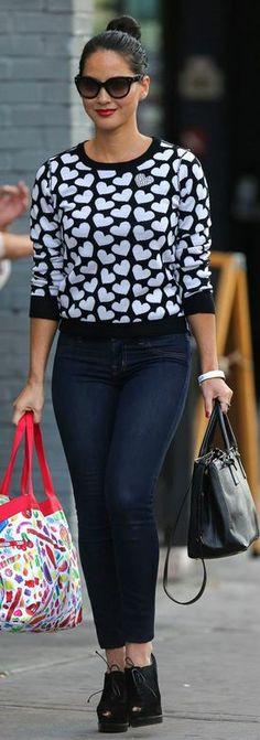 Who made Olivia Munn's white heart sweater and black tote handbag that she wore in New York on September 30, 2013?