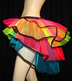 look 8 Ravey tulle fluorescent neon rainbow tutu skirt with old school bustle. MUST BUY, then I'll add lights to it; probably both LEDs within layers & EL wire along edges. Futuristic Cyndi Lauper style, bop she bop! Meme Costume, Costume Ideas, Rainbow Tutu, Neon Rainbow, Rainbow Pride, Rainbow Colors, Rave Gear, Ribbon Skirts, Tulle