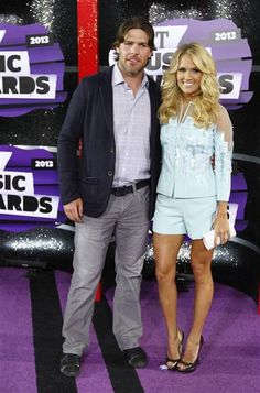 Mike Fisher & Carrie Underwood attend the 2013 CMT Music Awards
