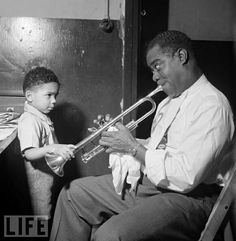 By the early Louis Armstrong had already revolutionized jazz. Through the next four decades, he would continue to reinvent himself. Along the way, he produced landmarks of the century in American music and entertainment. Jazz Artists, Jazz Musicians, Music Artists, Louis Armstrong, National Archives, Jazz Blues, Life Magazine, Music Stuff, Musicals