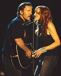 "The Rising: Bruce Springsteen shares a microphone with his wife Patti Scialfa and Steven Van Zandt of the E Street Band during ""The Rising"" Tour at the Los Angeles Forum on August 24th, 2002. Description from pinterest.com. I searched for this on bing.com/images"