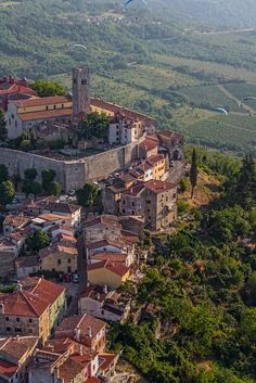 Breathtaking view - paragliding over hills and vineyards of medieval town of Motovun in central Istria, Croatia