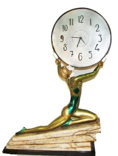 Period Art Deco bronze and ivory figural clock on marble base by Gmomma