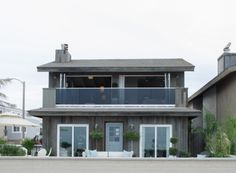 Jay added tons of tall windows and sliding doors to make a beach view from anywhere in the house! Automatic Garage Door, Garage Door Lock, Lowes Hardware, Home Security Tips, Tall Windows, Home Builders, Jay, Beach House, Mansions
