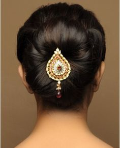 Flower Petal style bun, up-do, with center detail piece.