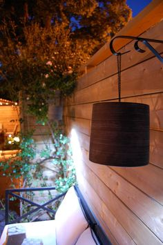 Outdoor lamp made with plastic pot & led lamp all purchased form the dollar store. Love it