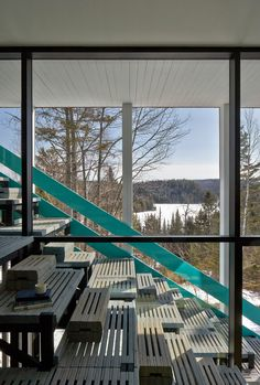 An exterior stair with a dramatic turquoise railing crosses the facade of this cubic-shaped home in rural Quebec by the Montreal-based studio Architecturama Concrete Interiors, Home By, Exterior Stairs, Stairway To Heaven, Apartment Interior, Turquoise, Aqua, Stairways, Art And Architecture