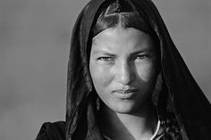 Mona Lisa Smile ( well almost ) Tuareg woman, Sahara Desert, Mali, West Africa  Copyright 2009 Robert moran Photography  This woman originally walked away from my camera - I followed her into the desert dunes - and after about 5 minutes of pursuit, she turned and posed - then walked away ... without a word spoken.
