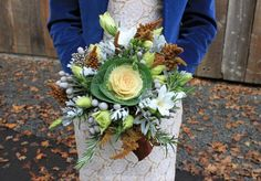 Bridal bouquet with ornamental kale, amaranthus, freesia, silver brunia and dusty miller with rosemary accents wrapped in brown silk ribbon.