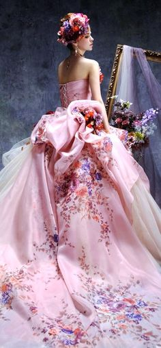 Beautiful pink couture gown with a pretty white tulle gathered skirt under pink satin. Lovely flower detail