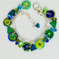 Charm Bracelet by San Antonio Artist Susan Butler / etsy Conbrio [so easy to wear with the oversize clasp!]